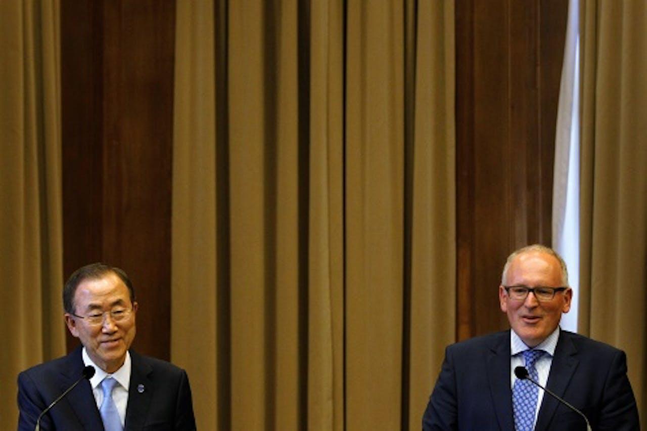 Ban Ki-moon (L) en Frans Timmermans. ANP