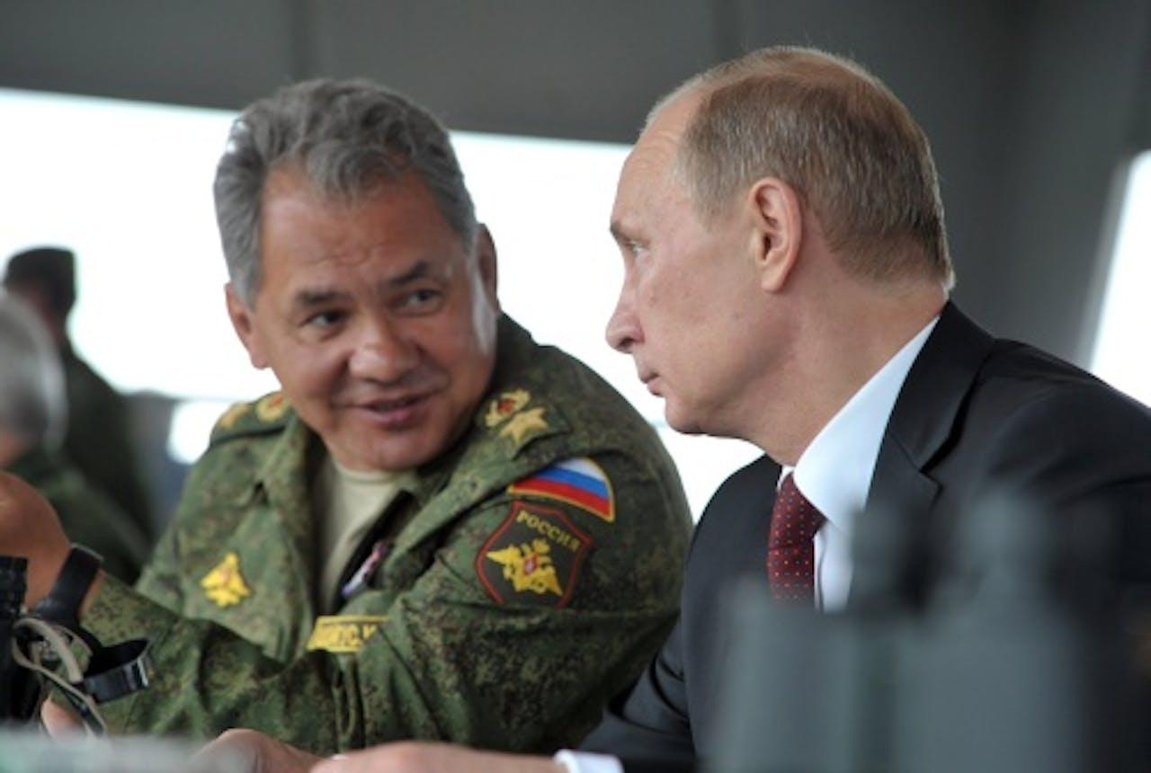 Sergej Sjojgoe en president Poetin. EPA