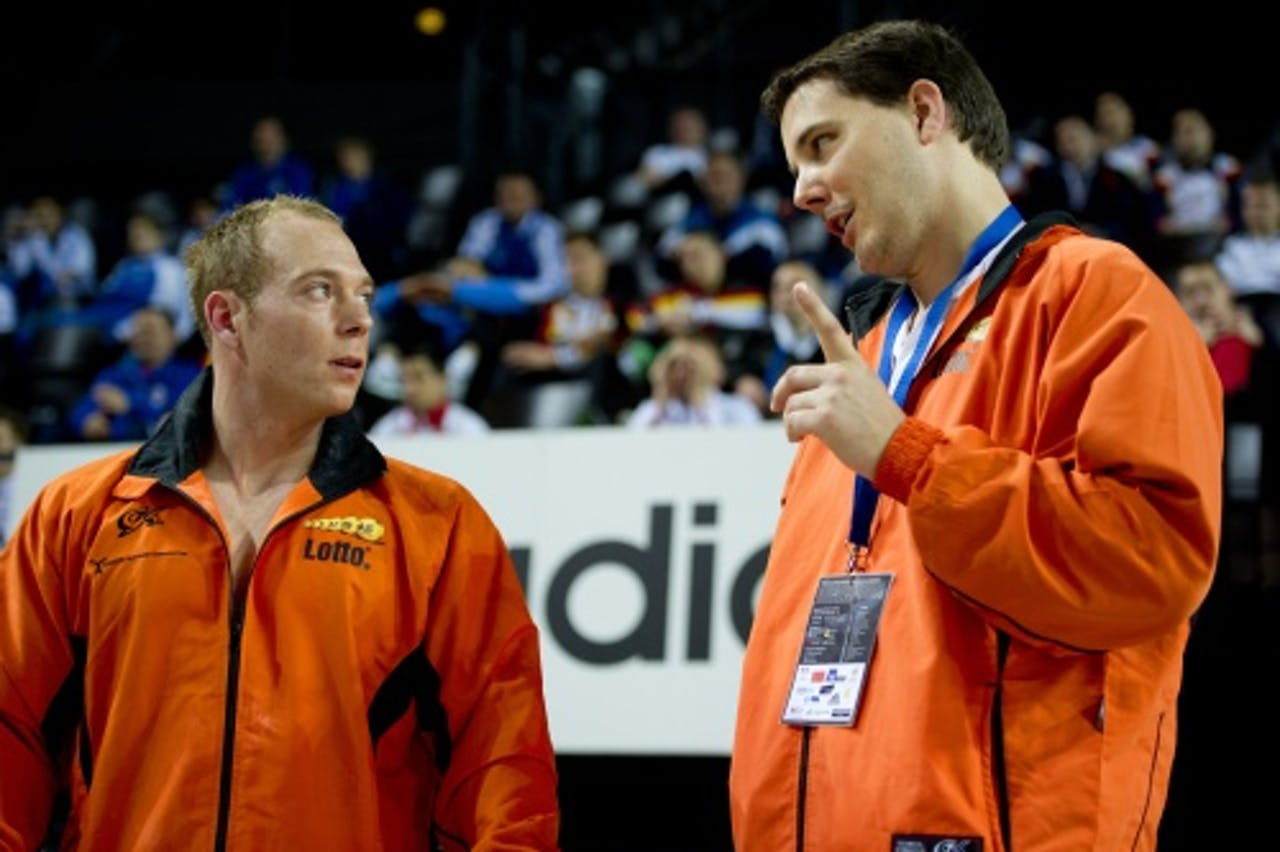 Yuri van Gelder met zijn coach Bram van Bokhoven op archief, ANP