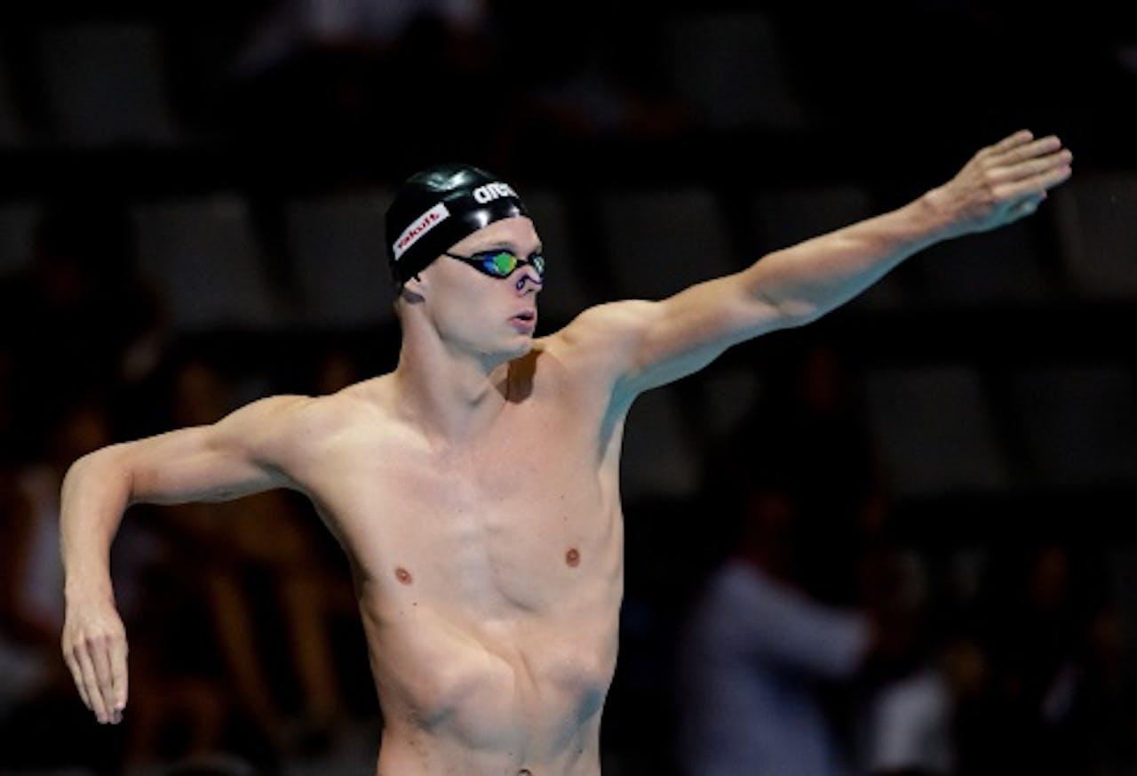 Bastiaan Lijesen in actie tijdens de series van de 50 meter rugslag op het WK zwemmen in Barcelona, ANP