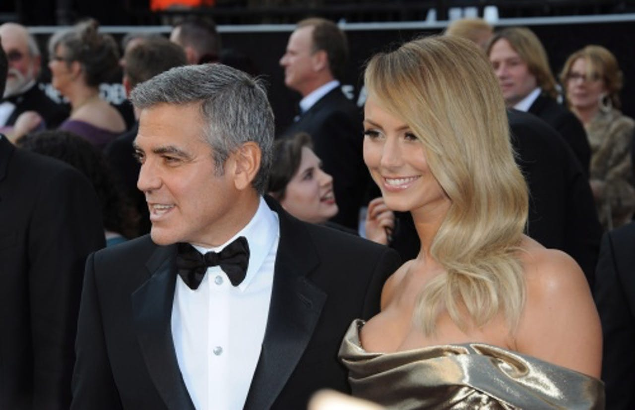 George Clooney (L) en Stacy Keibler (R). EPA