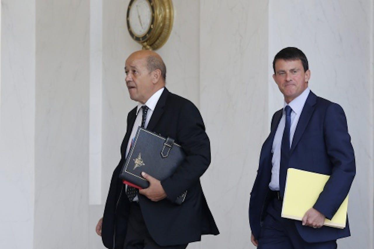 Jean-Yves Le Drian (L). EPA