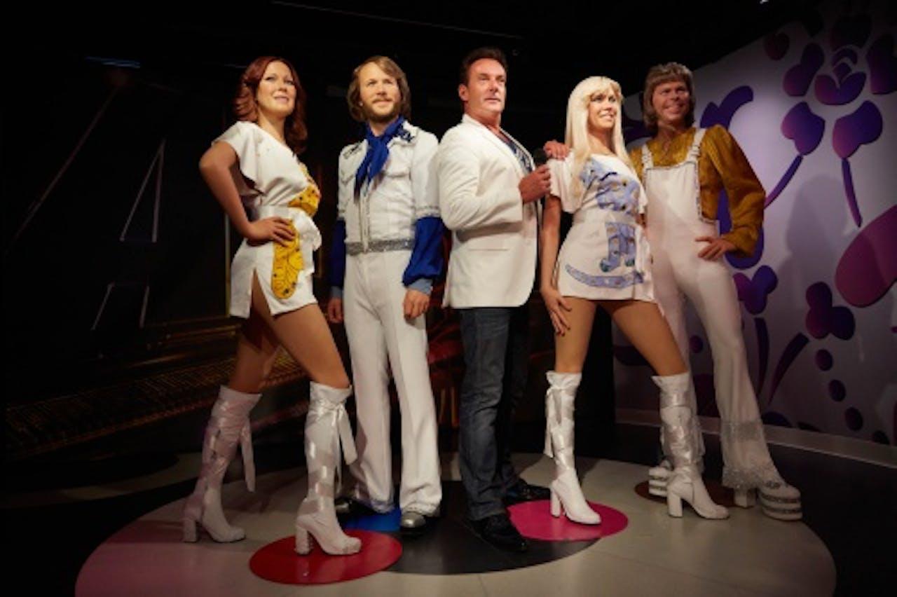 Gerard Joling tussen de ABBA-leden. ANP KIPPA