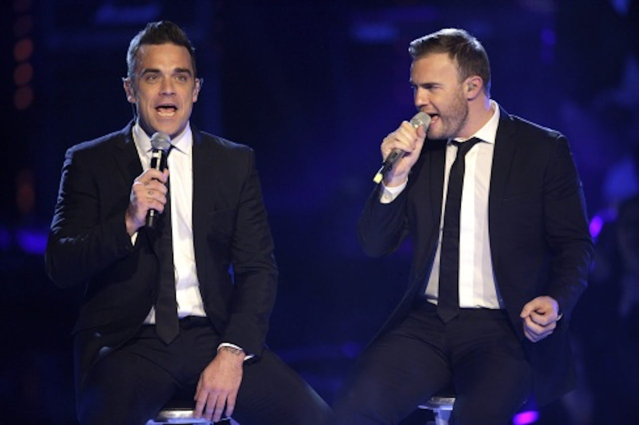 Gary Barlow met Robbie Williams. EPA