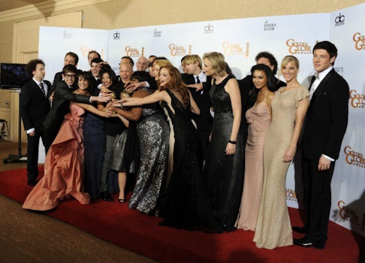 De cast van Glee, met uiterst rechts Cory Monteith. EPA