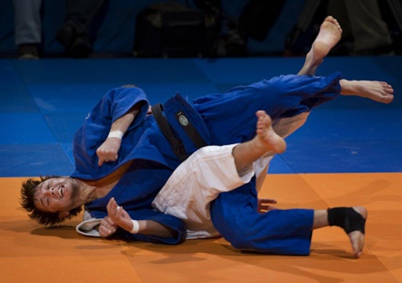 Mikos Salminen, in het blauwe pak, op archiefbeeld. ANP