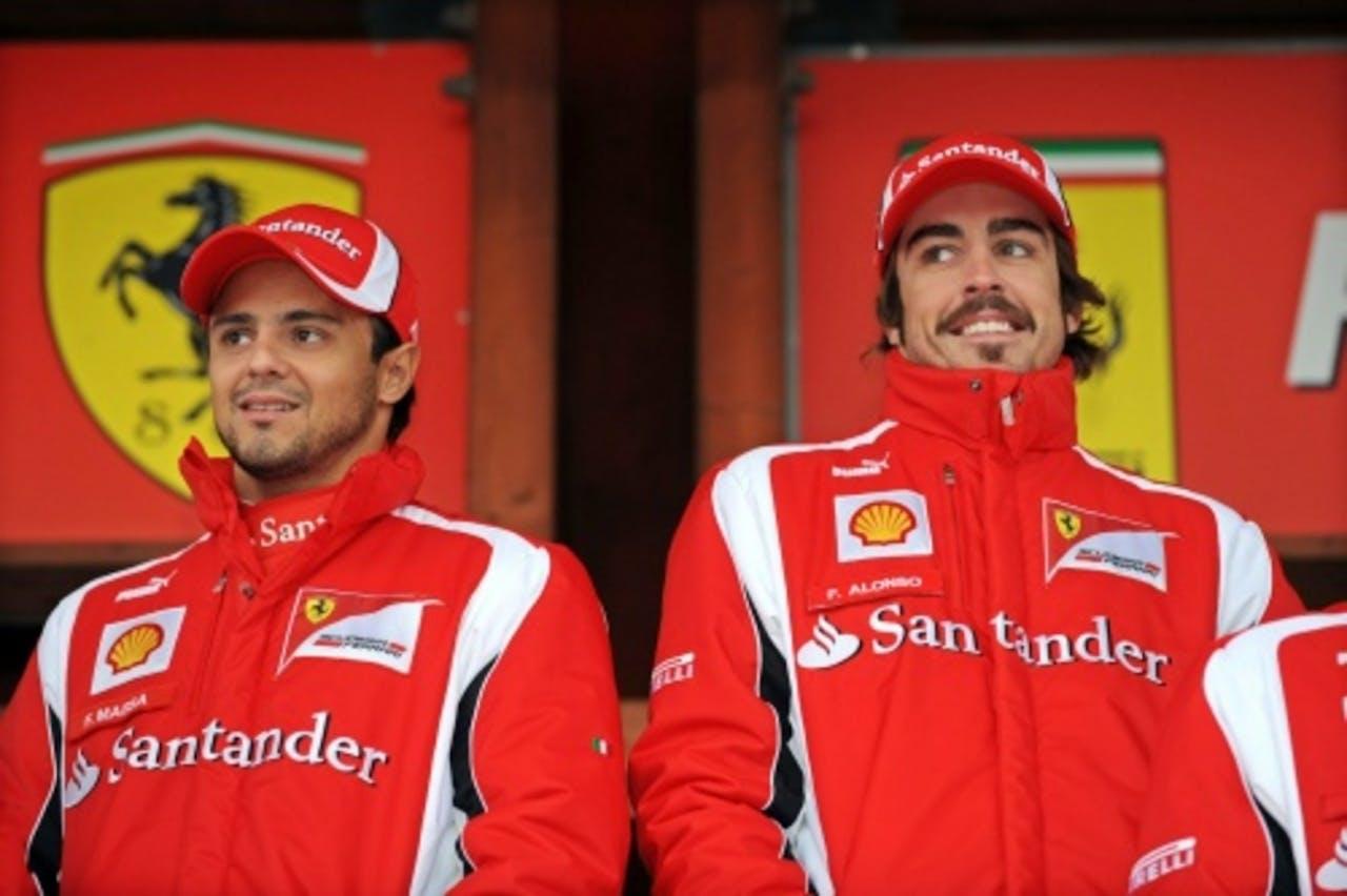 Felipe Massa (L) en Fernando Alonso (R). EPA