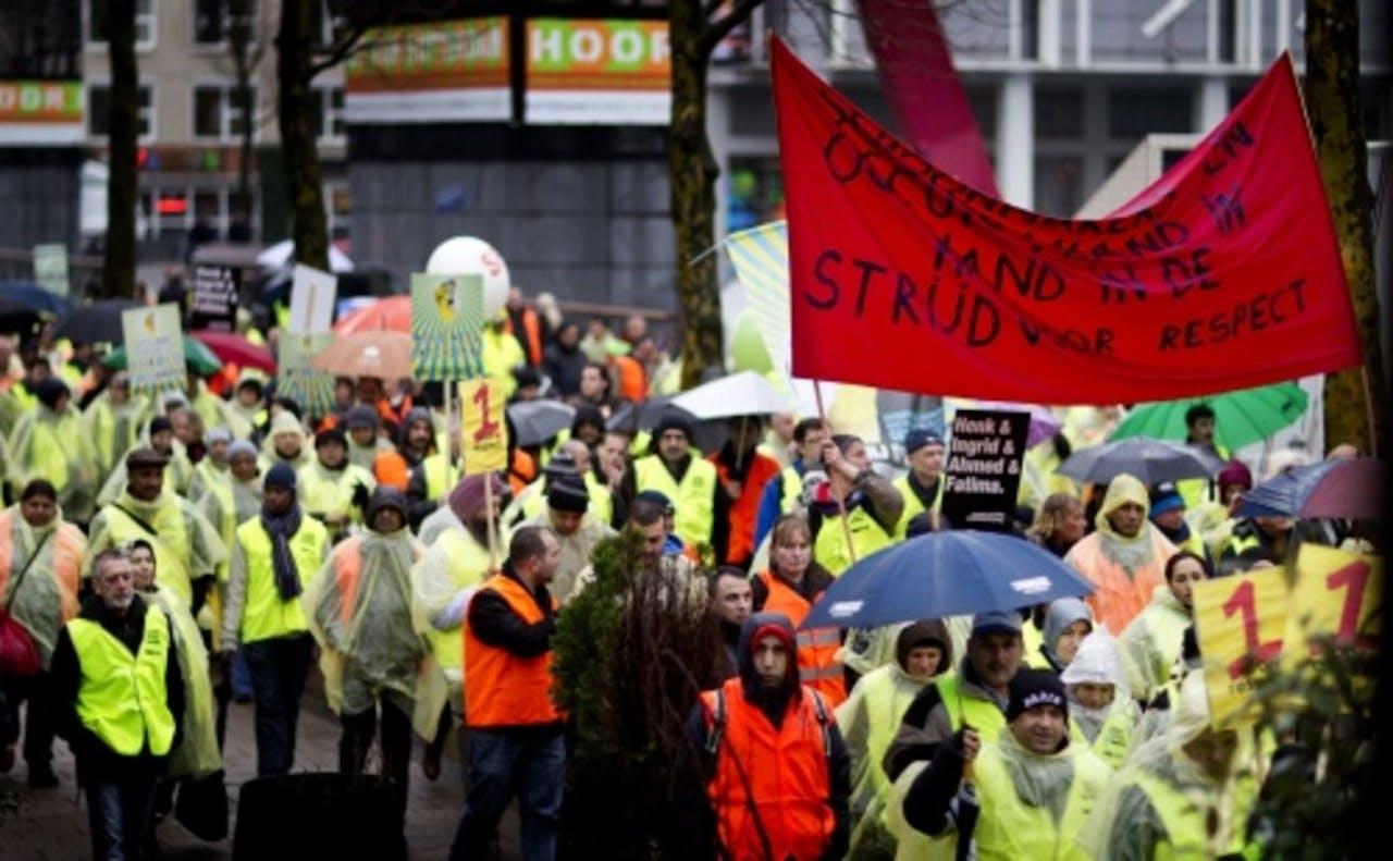 Schoonmakers tijdens een eerdere actie in Rotterdam. ANP