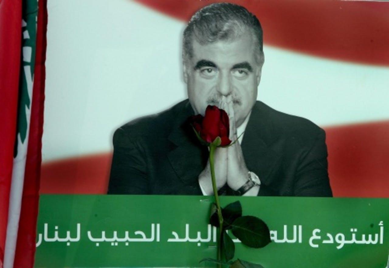 Een foto van Rafik Hariri bij een herdenking. EPA