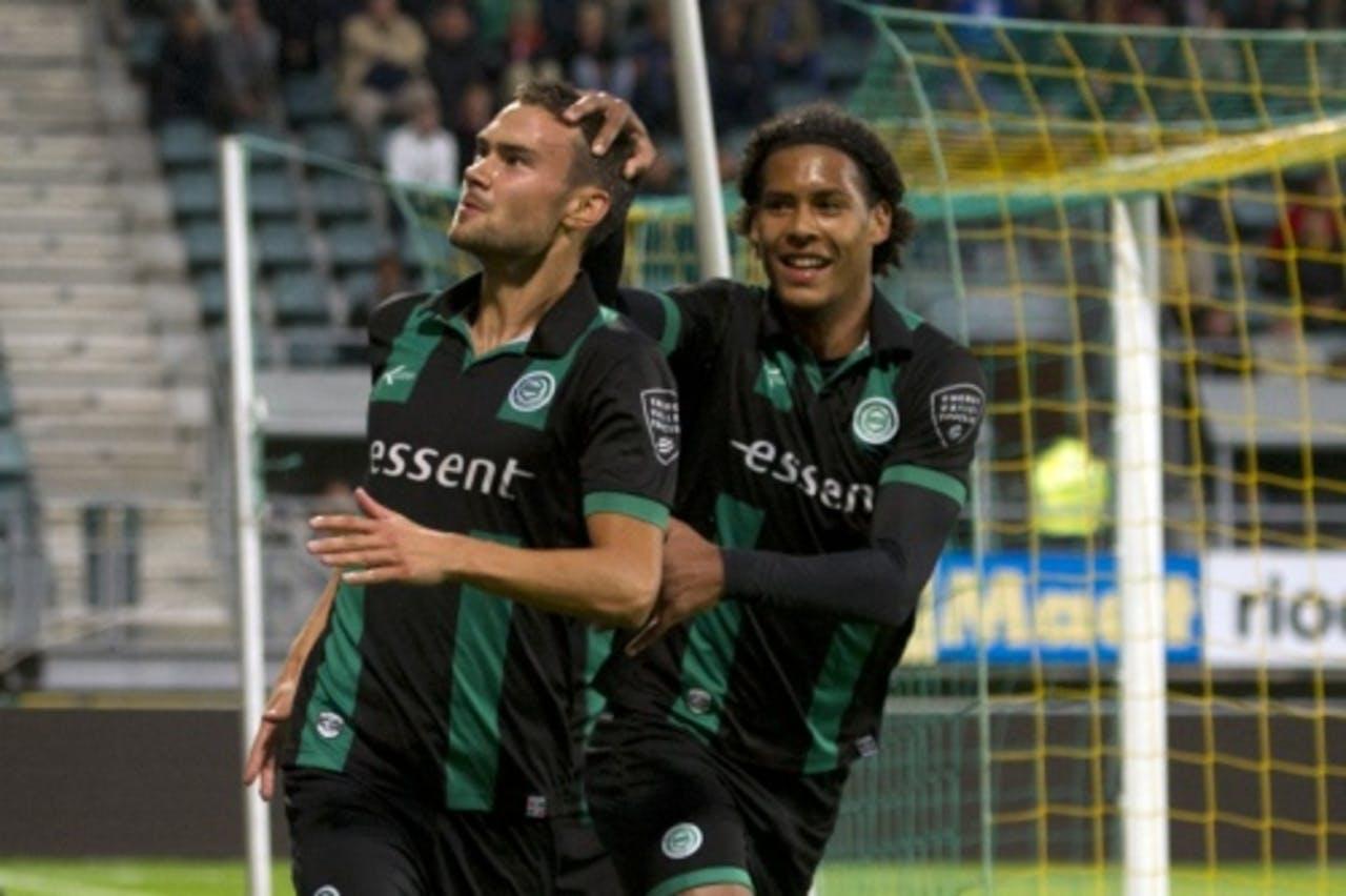 FC Groningen spelers Tim Sparv (L) en Virgel van Dijk (r) vieren de 0-1 tegen ADO. ANP