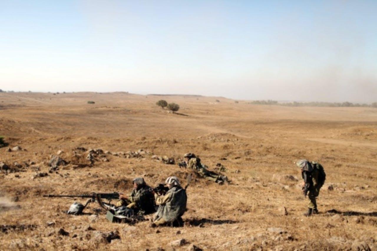 Israëlische militairen op patrouille in de golanhoogte.