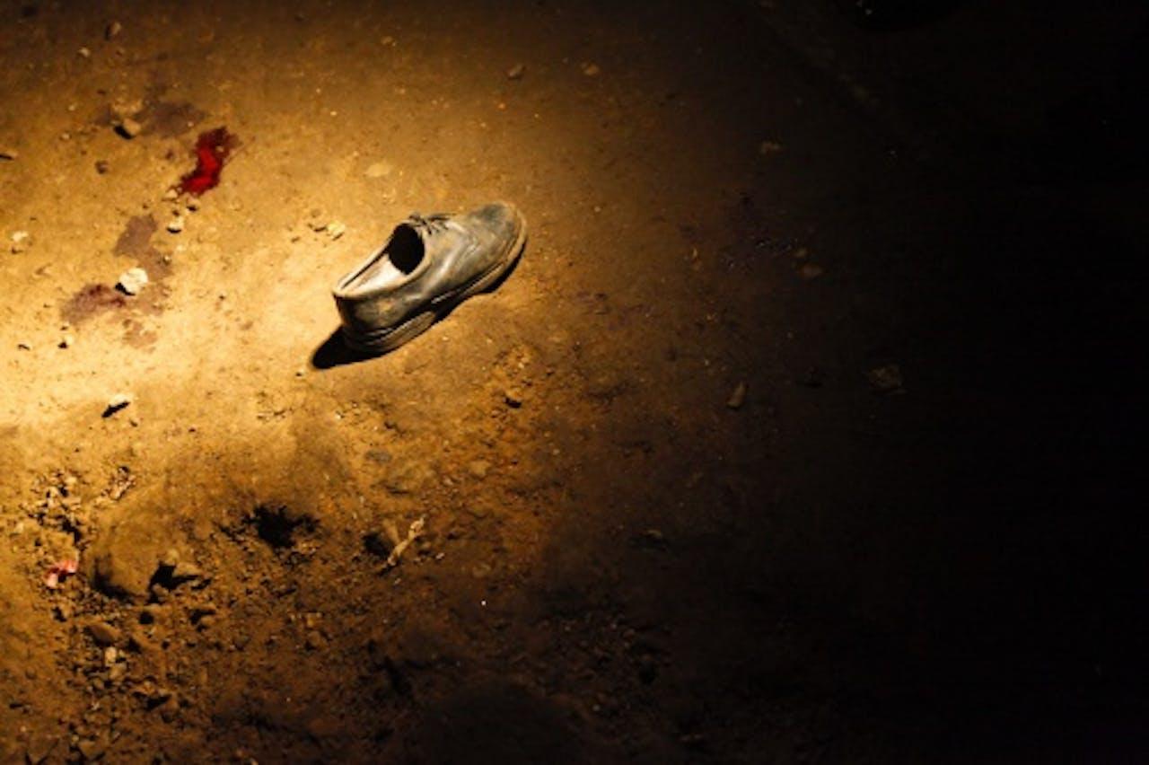 Een schoen naast een bloedvlek na een aanslag van al-Shabaab in Nairobi in oktober van vorig jaar. EPA