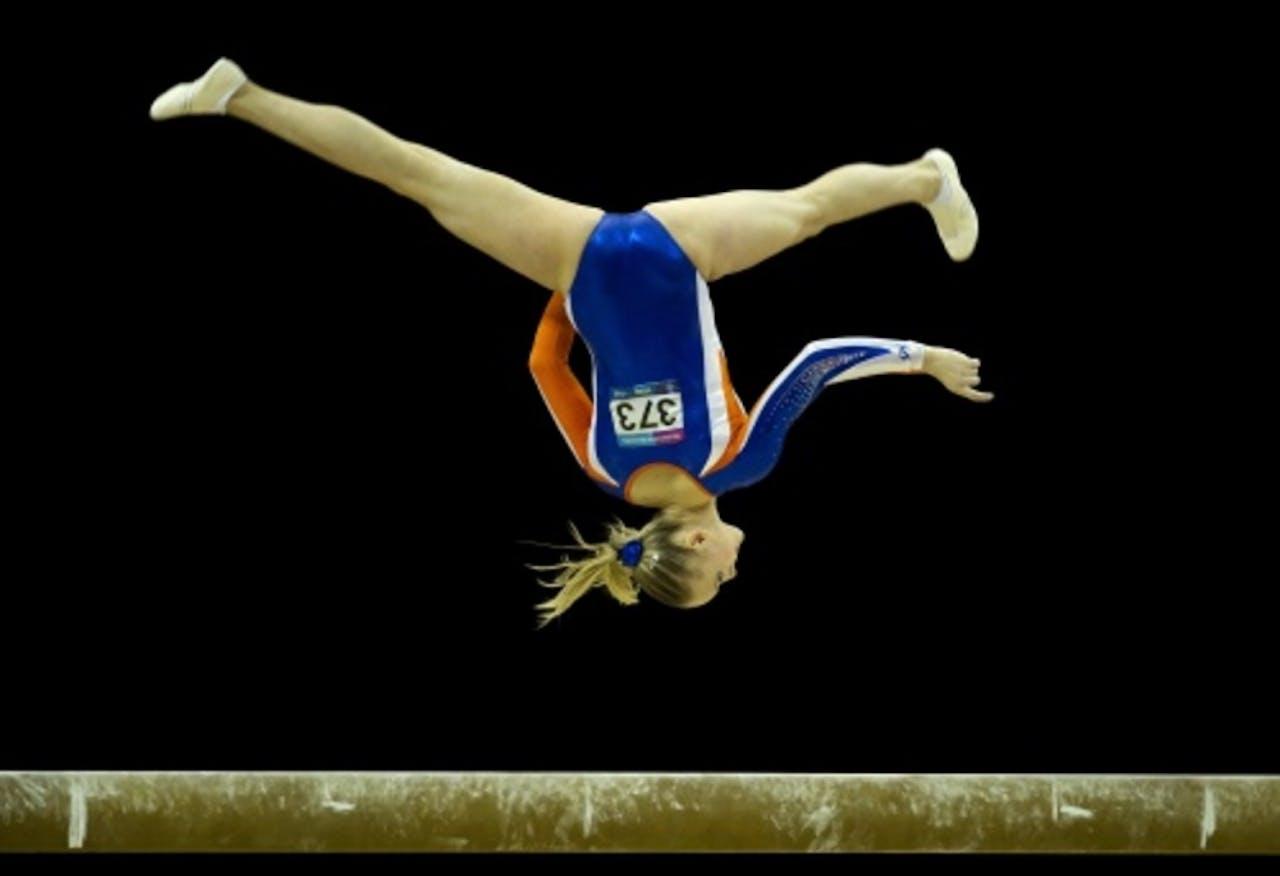 Lieke Wevers in actie op de evenwichtsbalk tijdens het Olympisch kwalificatietoernooi. ANP