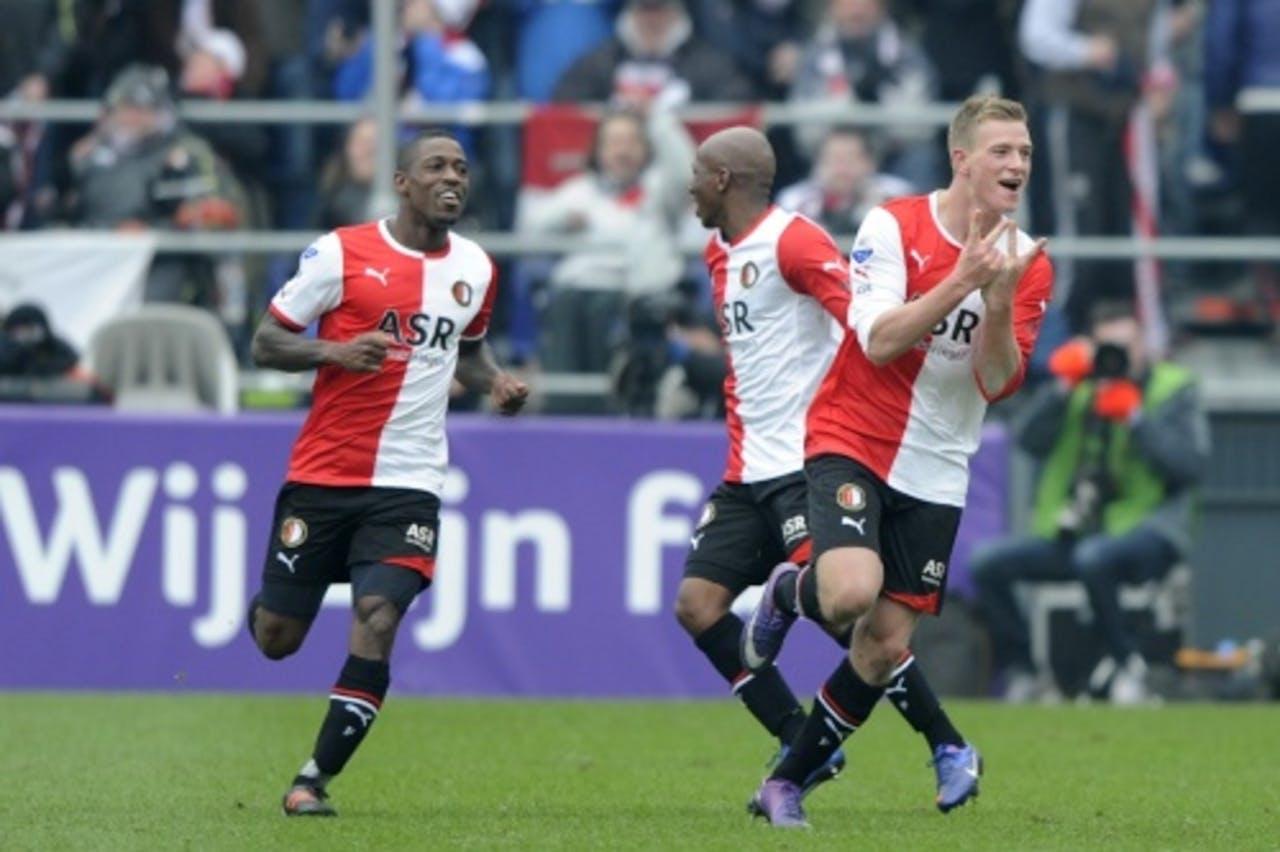 John Guidetti (R) juicht nadat hij Feyenoord op een 2-1 voorsprong heeft gezet. ANP