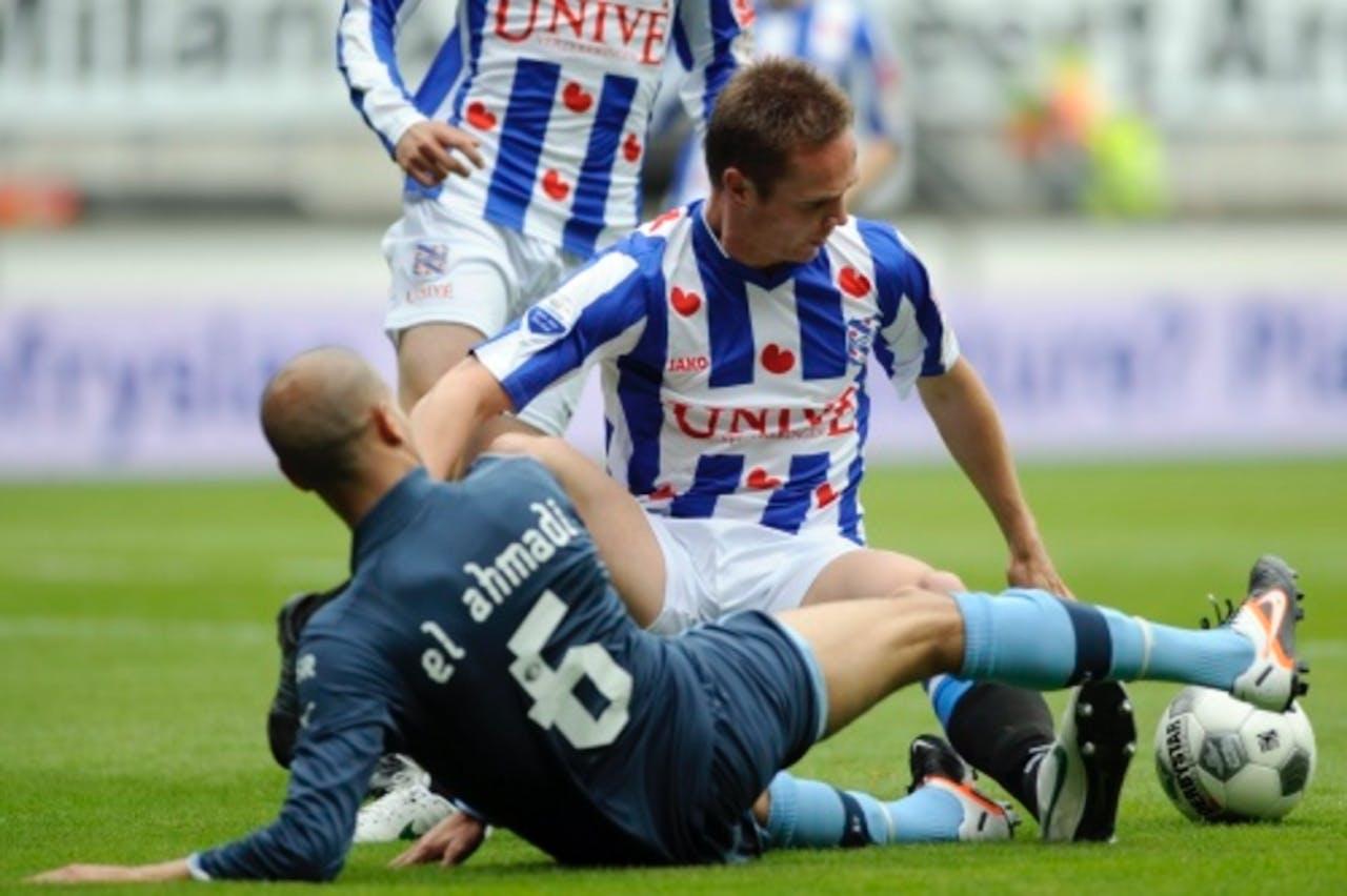Karim El Ahmadi (R) van Feyenoord in duel met Ramon Zomer van sc Heerenveen. ANP PRO SHOTS