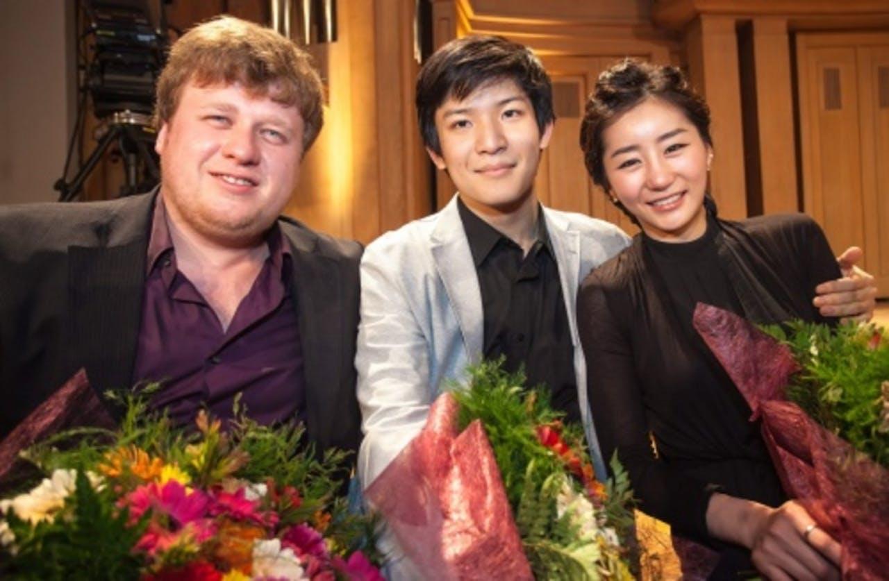 Andrey Baranov, Tatsuki Narita en Hyun Su Shin (vlnr). EPA