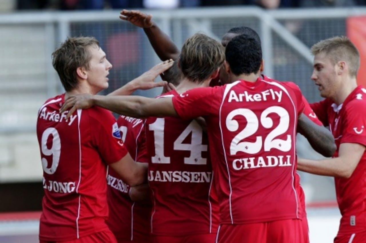 De spelers van FC Twente vieren de goal van Luuk de Jong (L). ANP