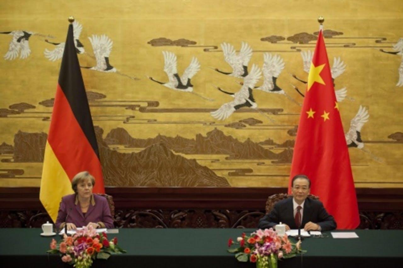 Donderdag had Merkel al een ontmoeting met premier Wen Jiabao. EPA