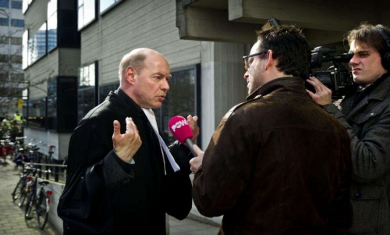 Advocaat Wim Anker (L). ANP