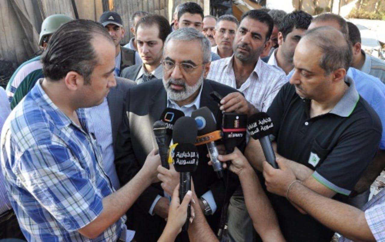 Omran Zoabi, de Syrische minister van Informatie die eerder 'condoleances' aanbood. EPA