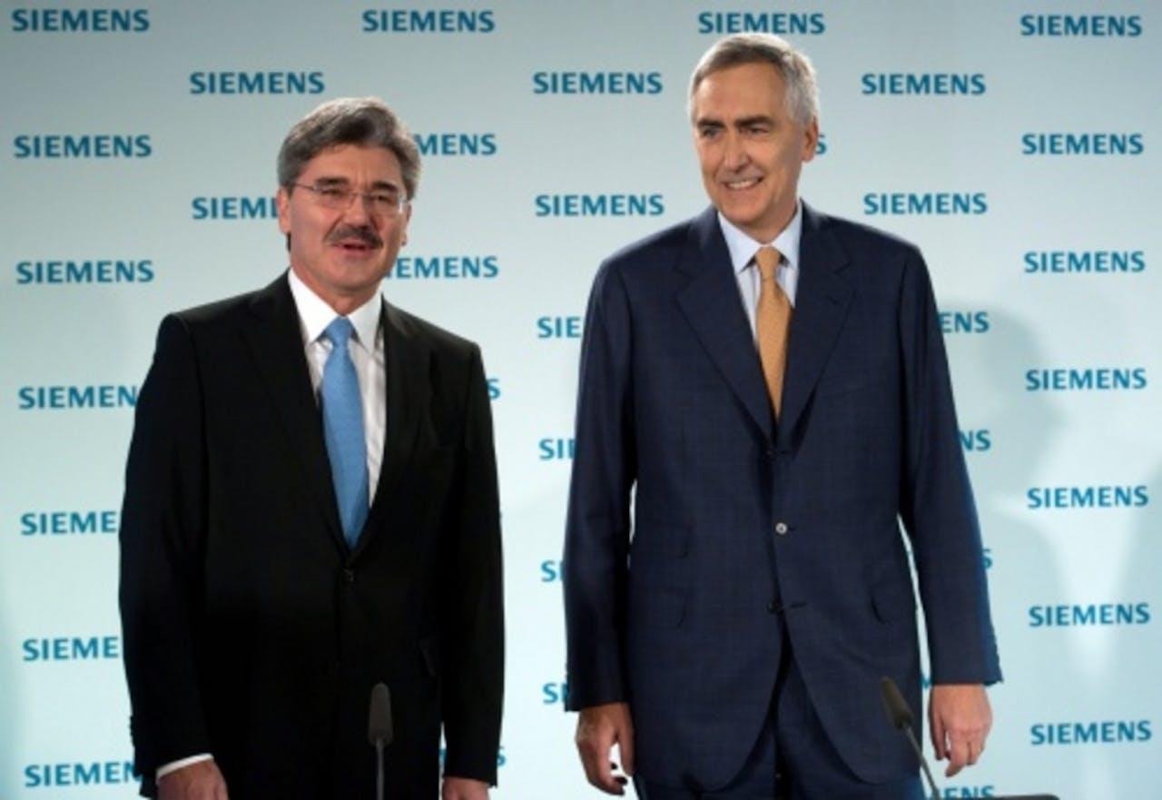 Financieel directeur Joe Kaeser (L) en algemeen directeur Peter Loescher (R) van Siemens. EPA