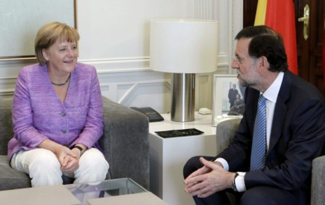 Mariano Rajoy en Angela Merkel. EPA