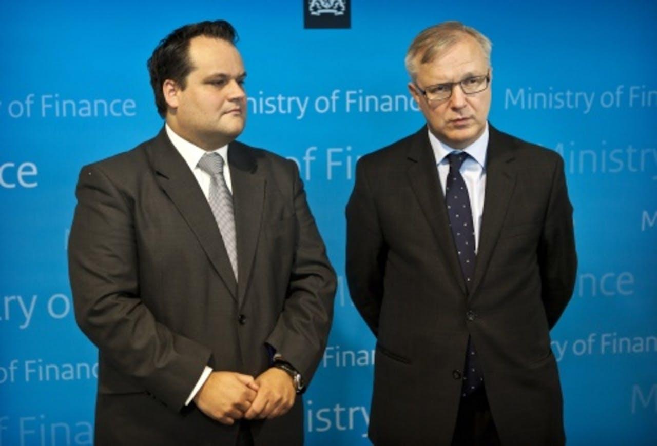 Minister Jan Kees de Jager samen met Europees commissaris Olli Rehn. ANP