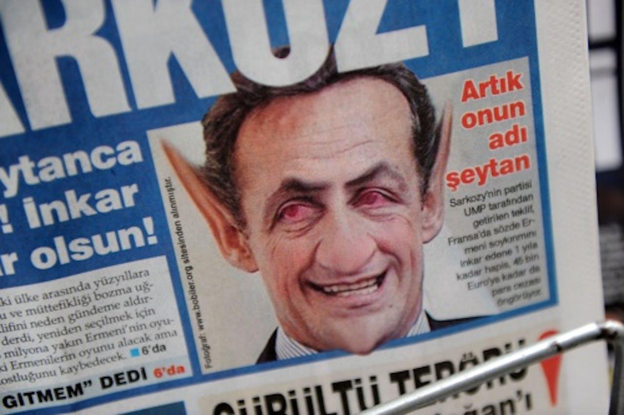 De Franse president Sarkozy afgebeeld als een duivel in een Turkse krant in januari. AFP