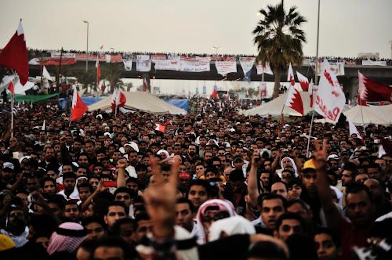 Anti-regeringsbetogers op de stratem vam Manamah in februari dit jaar. EPA