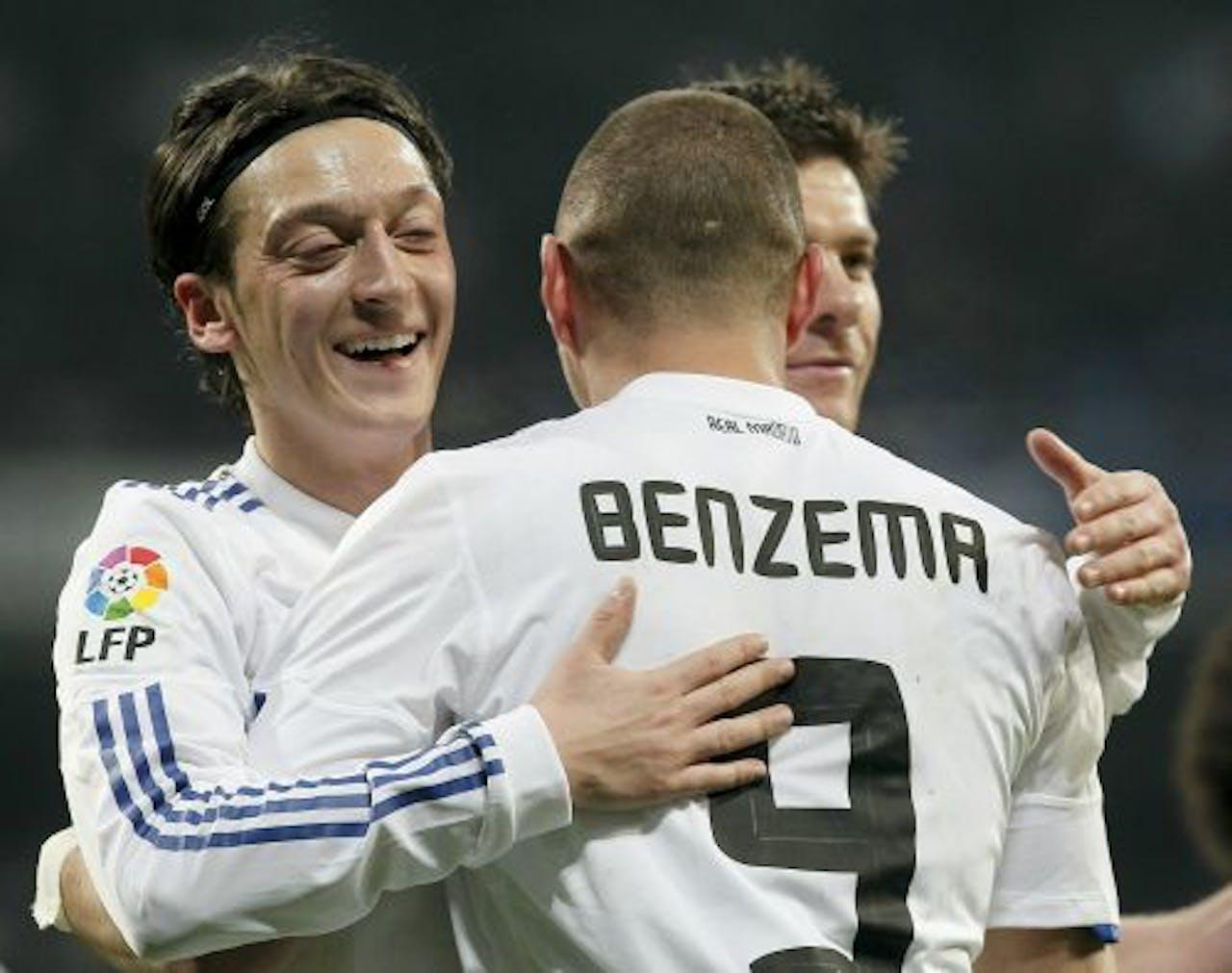 Vreugde bij spelers van Real Madrid, na het doelpunt van Karim Benzema. EPA