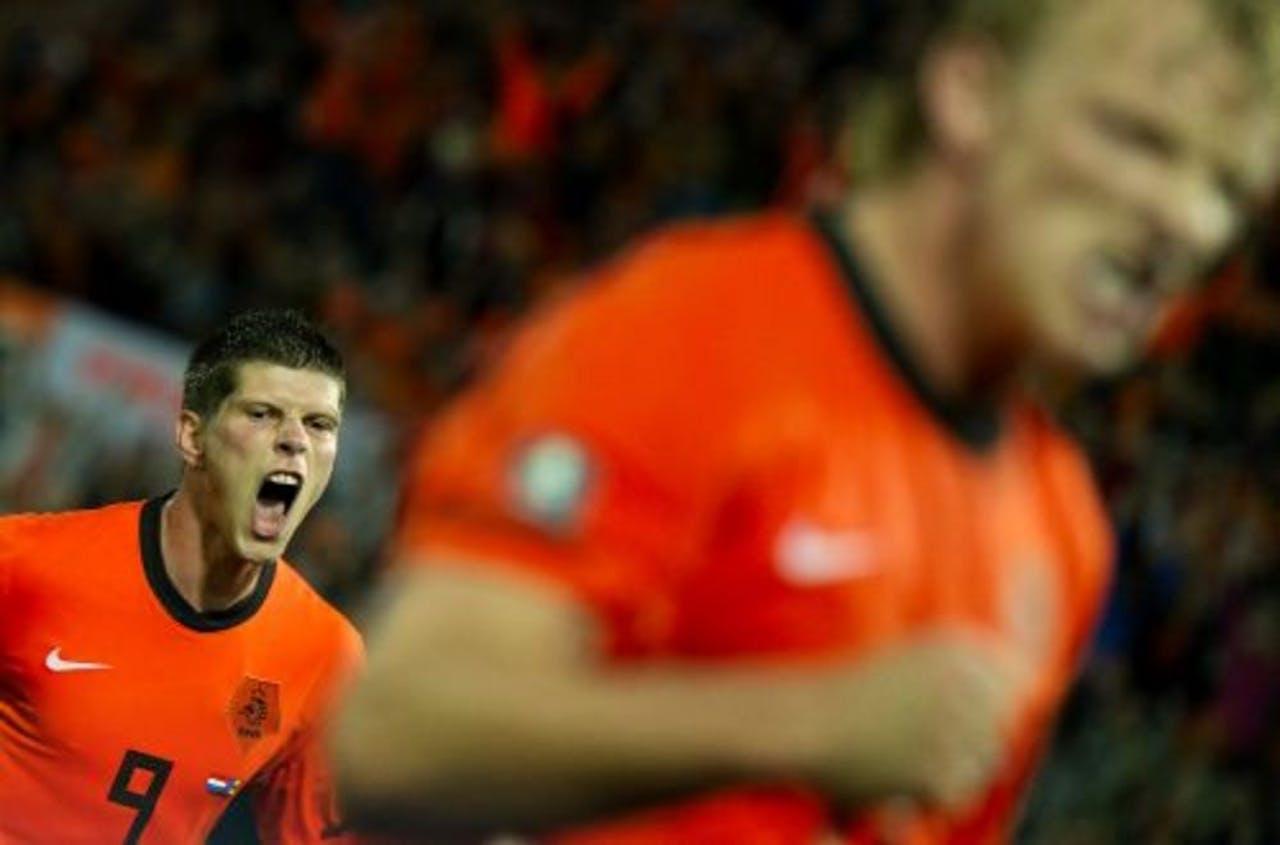 Klaas-Jan Huntelaar viert zijn 1-0 met Dirk Kuyt. ANP