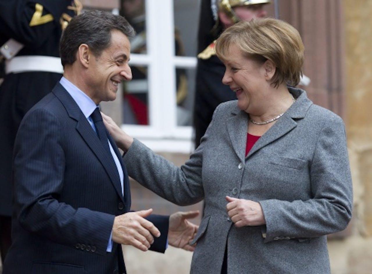 De Duitse bondskanselier Angela Merkel (R) en de Franse president Nicolas Sarkozy (L). EPA