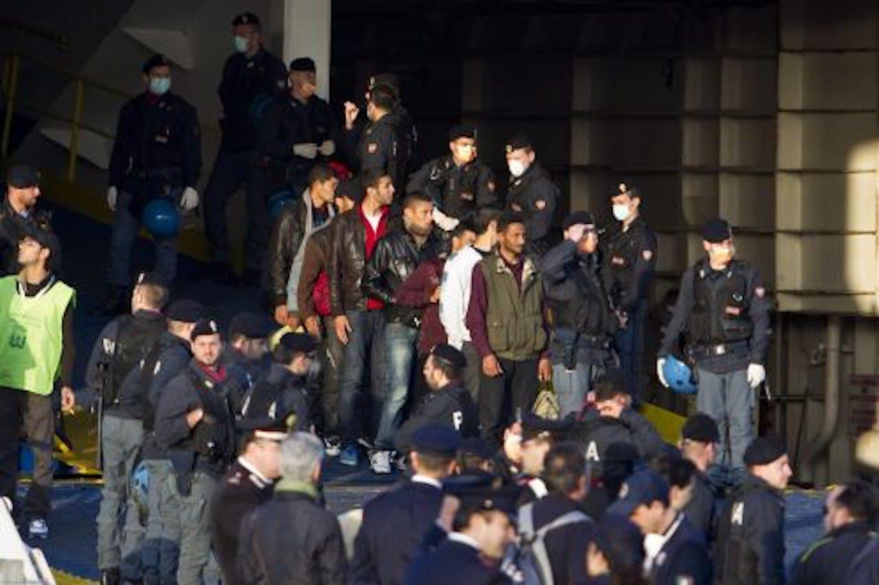 Tunesische vluchtelingen proberen Italië binnnen te komen. EPA