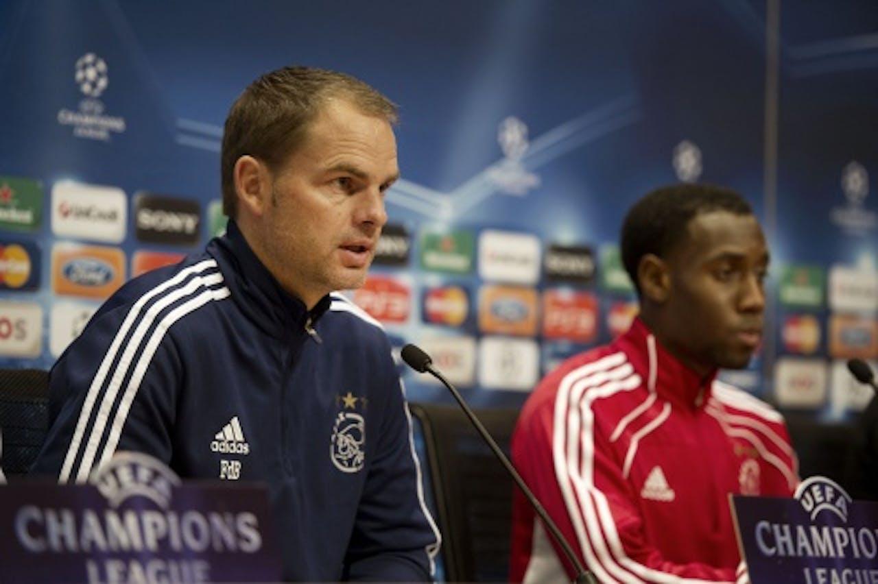 Ajax-trainer Frank de Boer (L) en middenvelder Vurnon Anita (R). ANP