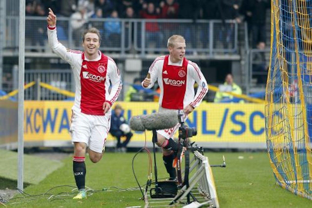 Christian Eriksen (L) en Davy Klaassen (R) van Ajax vieren de 0-1 van RKC-speler Guy Ramos. ANP
