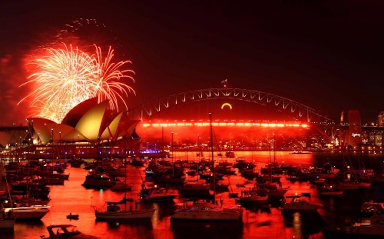 De Australiërs kregen drie uur voor de grote vuurwerkshow alvast een voorproefje. EPA