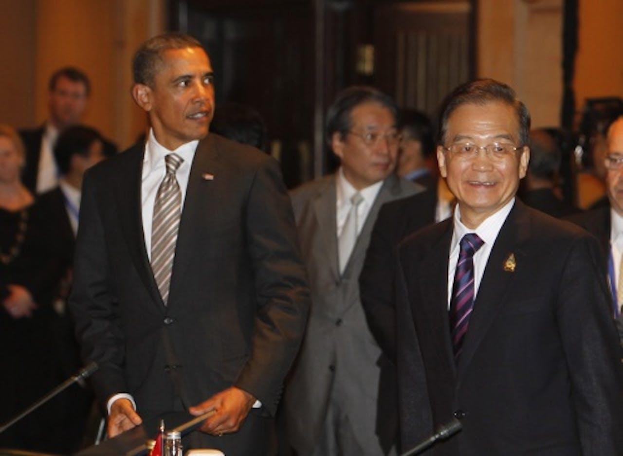 De Amerikaanse president Barack Obama (L) en de Chinese premier Wen Jiabao (R). EPA