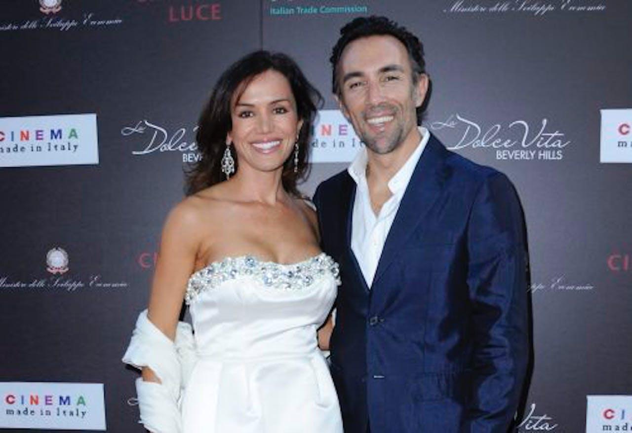 Quinn met zijn vrouw Valentina Castellani tijdens een première in juni 2011. EPA