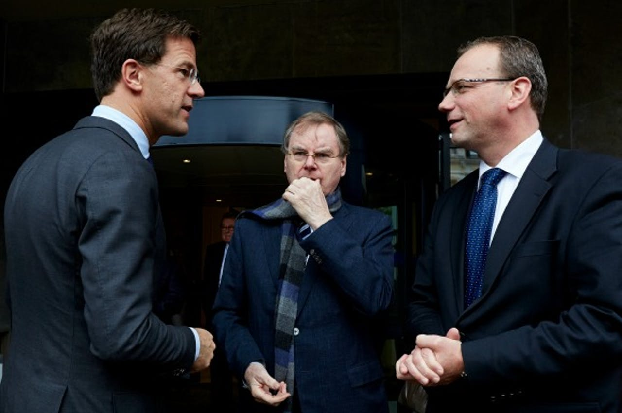 Premier Rutte en vertrekkend FNV-voorzitter Ton Heerts (rechts). Foto ANP