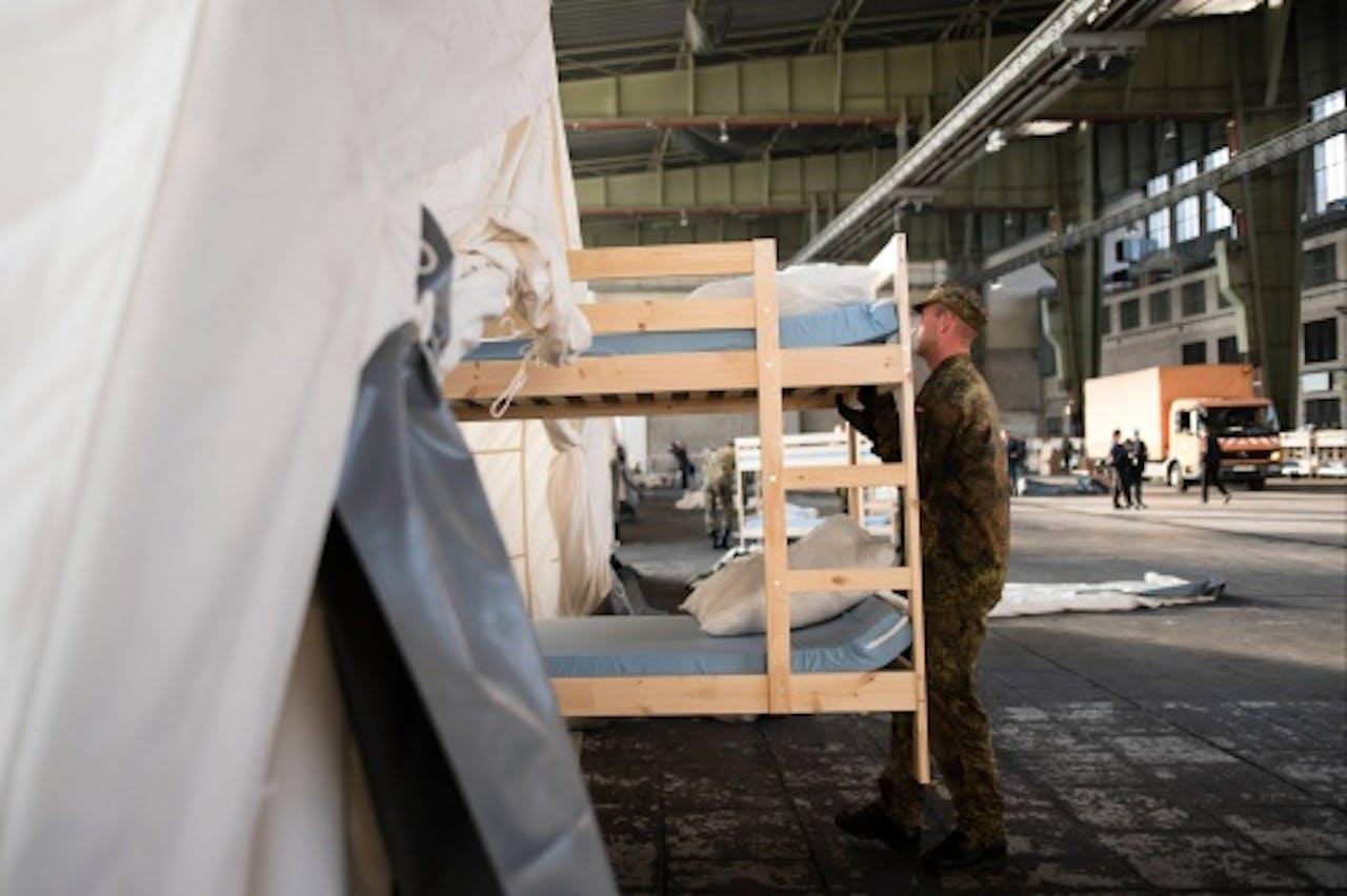Duitse militairen helpen bij de opvang van vluchtelingen (EPA)