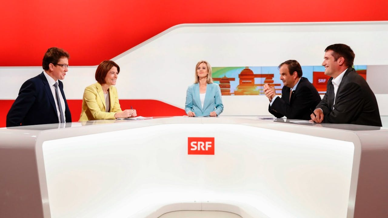 De leiders van de vier grootste partijen in Zwitserland bij een tv-uitzending over het referendum. Foto: ANP/EPA