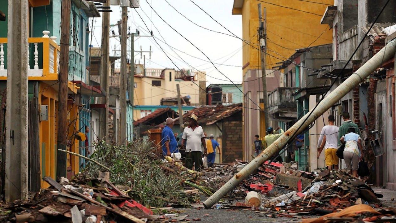 Schade van Matthew in het Cubaanse Baracoa. Foto: ANP/EPA