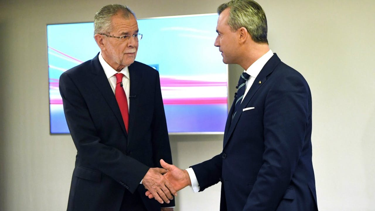 Alexander Van der Bellen (links) en Norbert Hofer. Foto: ANP/AFP
