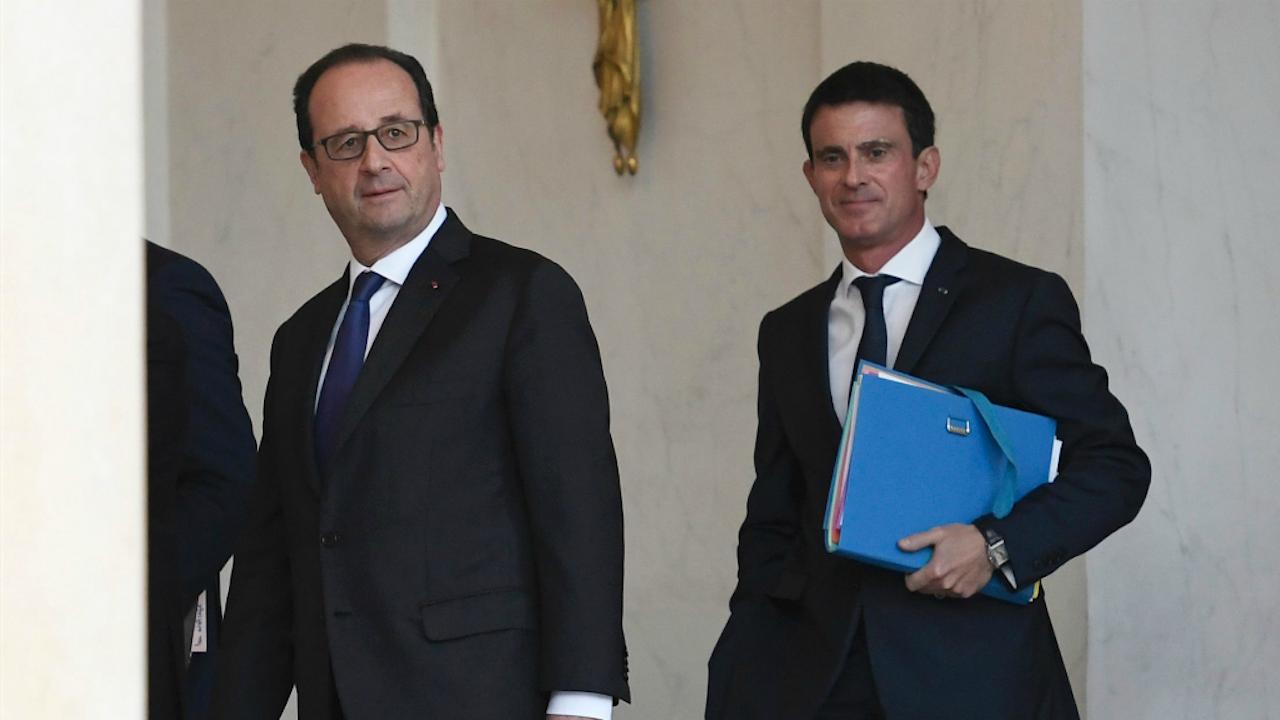 Valls (rechts) met Hollande. Foto: ANP/Stephane De Sakutin