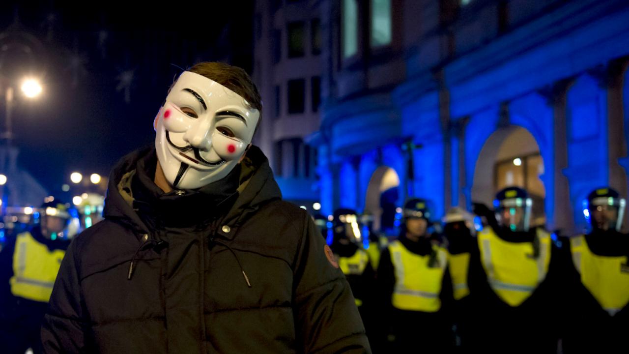 Anonieme demonstrant in Londen, afgelopen november (Foto: Hollandse Hoogte)