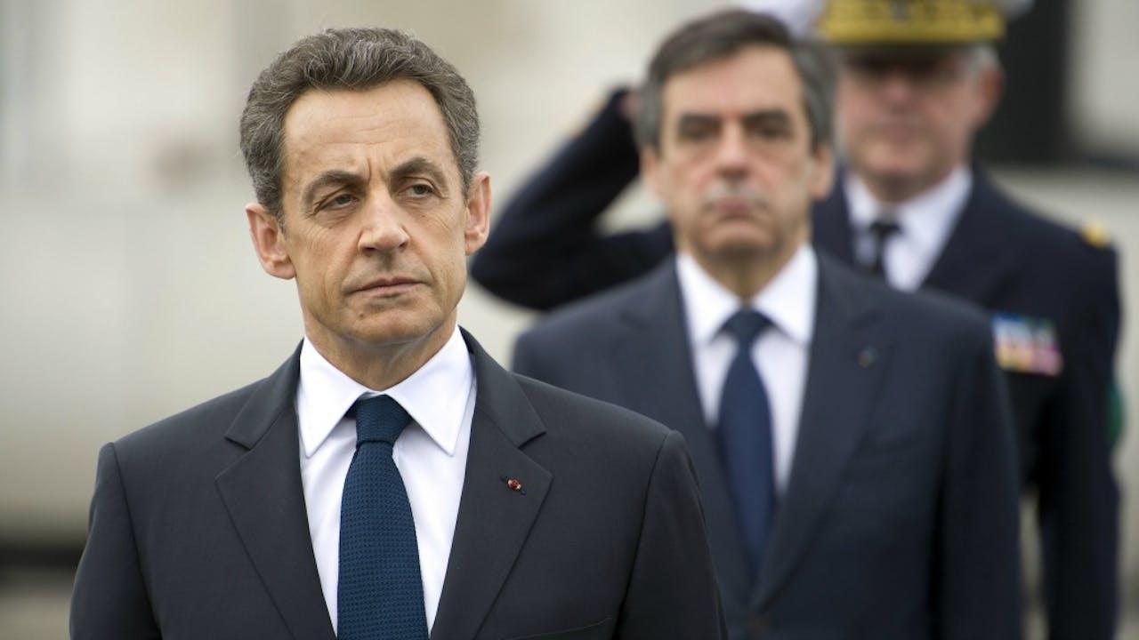 Nicolas Sarkozy in de tijd dat hij nog president was. Achter hem toenmalig premier François Fillon. Foto: ANP/AFP