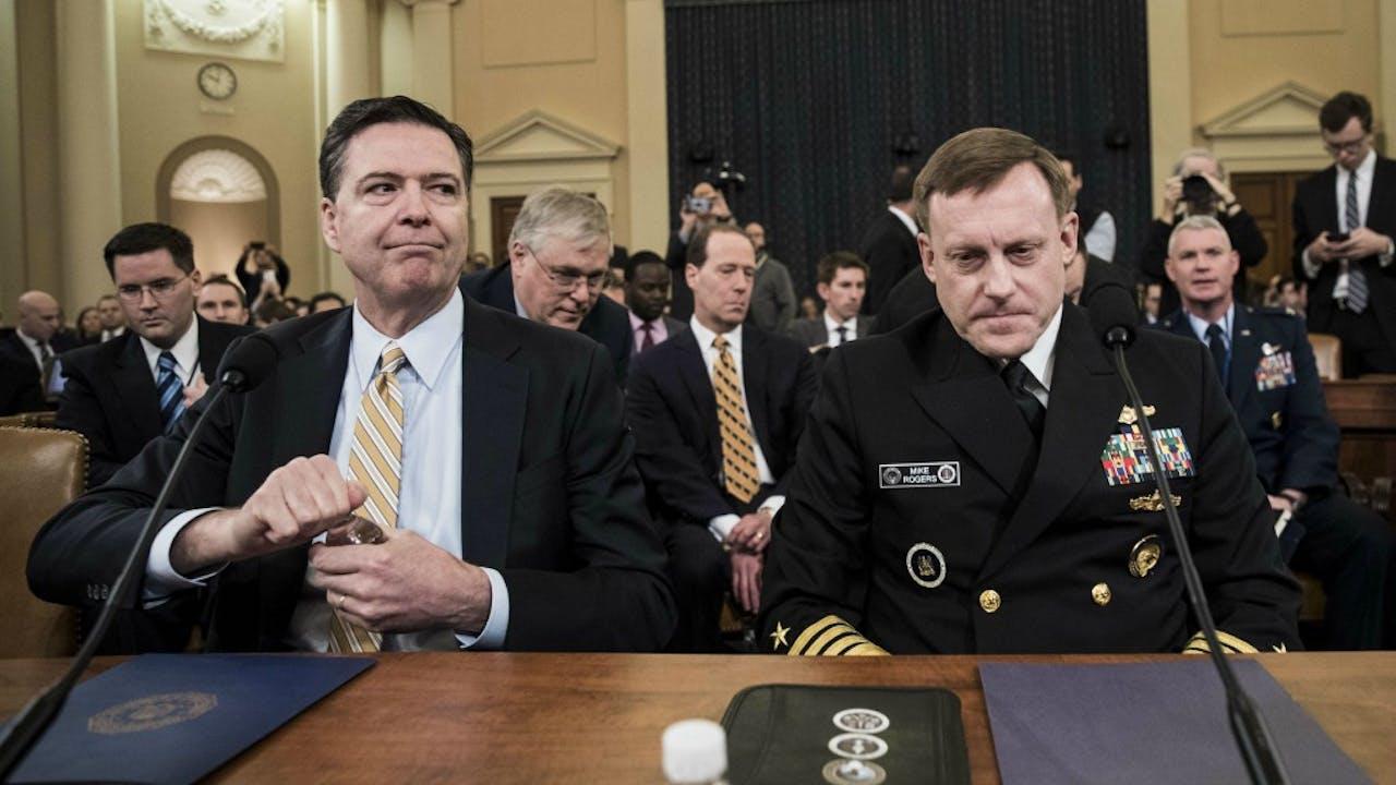FBI-directeur James Comey (links) en NSA-baas Michael Rogers. Foto: ANP.