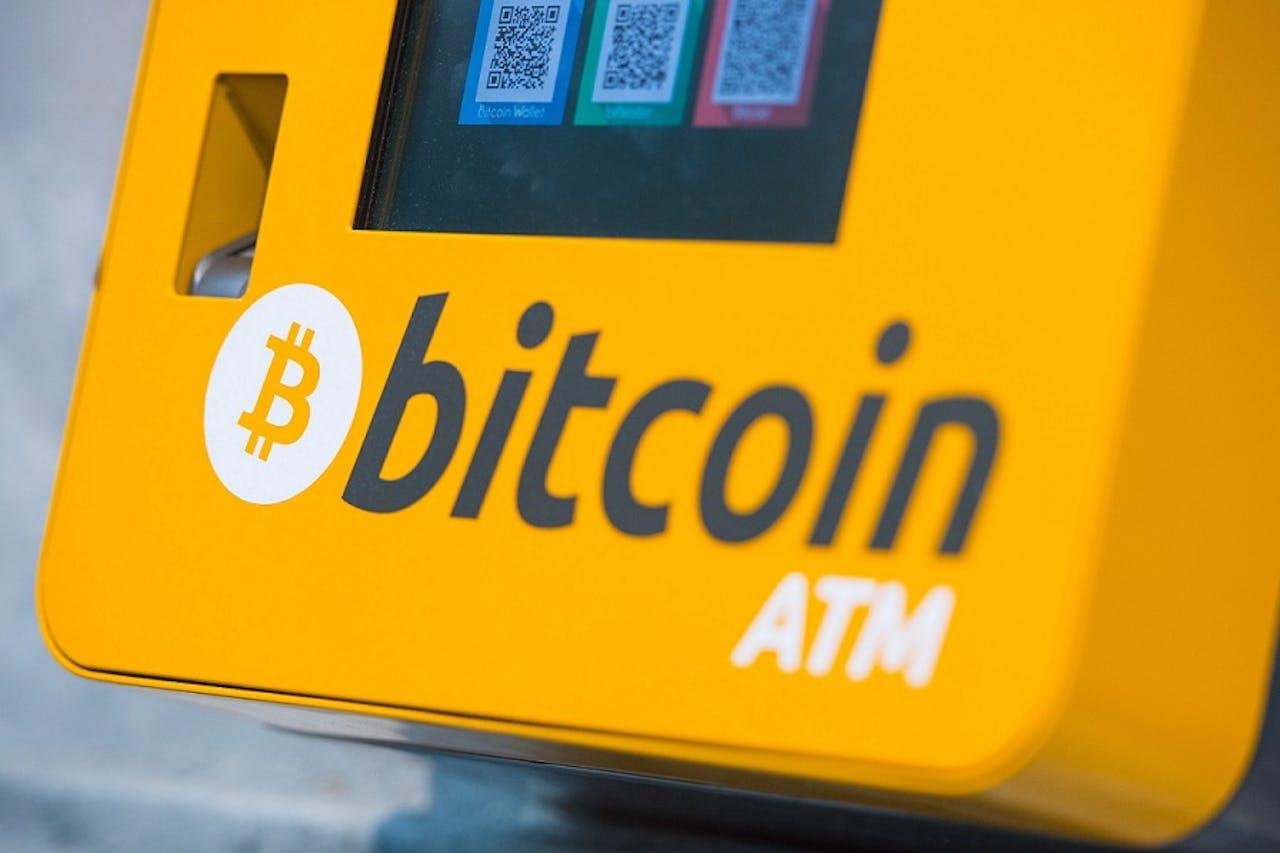 Een bitcoin-automaat, waar je 'gewoon' geld kunt omzetten in bitcoins en andersom. Beeld: Hollandse Hoogte