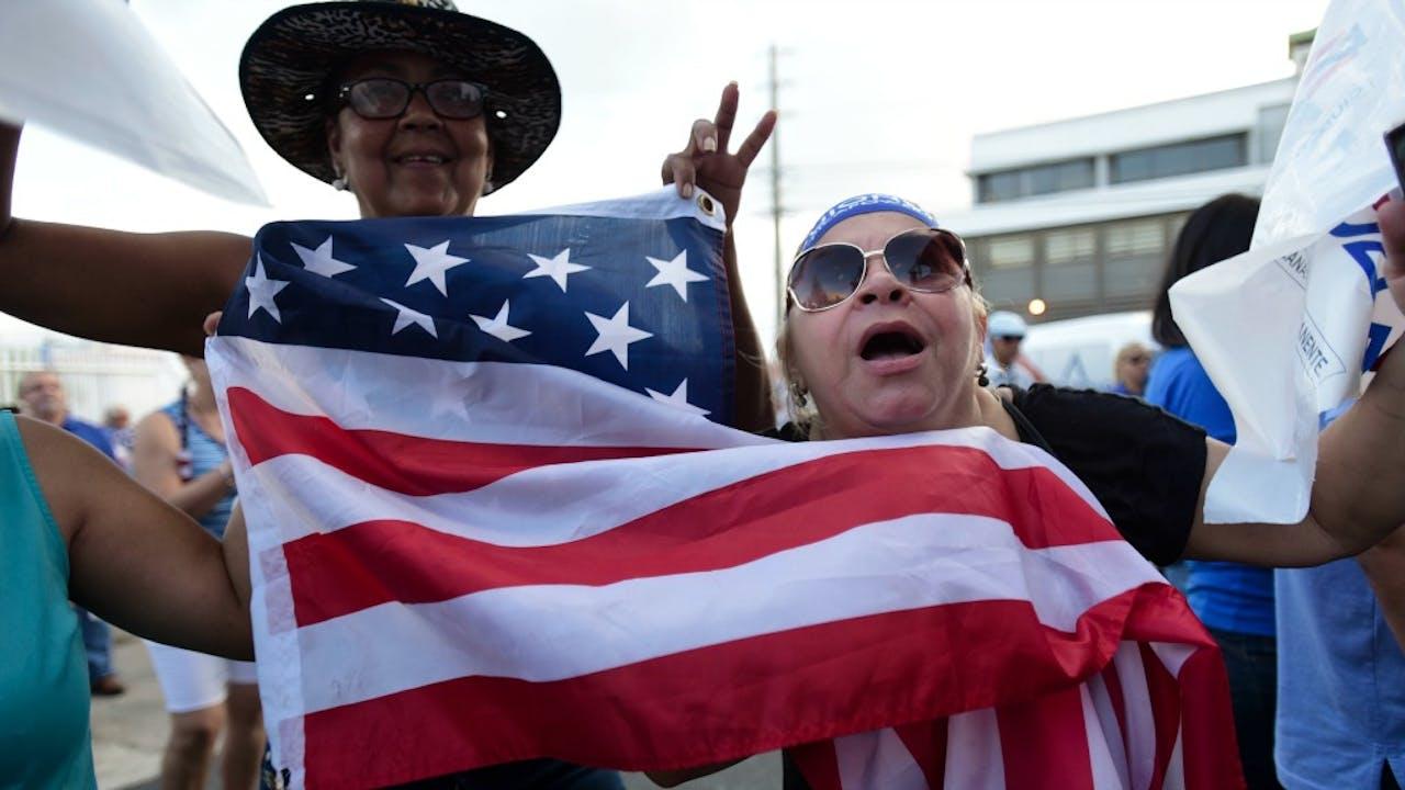 Puerto Ricanen vieren de uitslag van het referendum. Foto: HH/Carlos Giusti