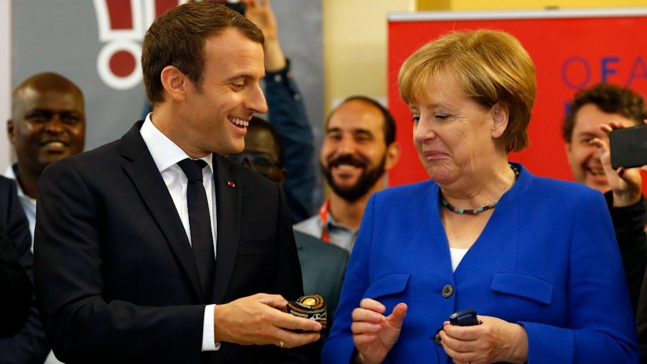 De Franse president Macron (links) en Bondskanselier Merkel. Foto ANP